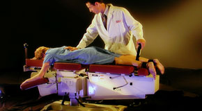 This is a picture of Cox Technic chiropratic spinal manipulation as performed at Dr. Hoang's Chiropractic Clinic.