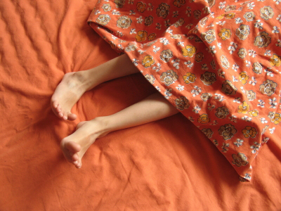 image of restless legs under covers